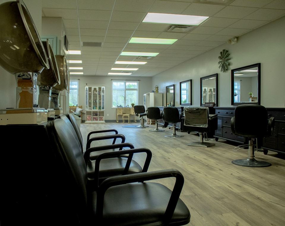 Picture of salon chairs , shampoo stations and dryers